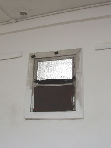 simulated window covering a hole made during the previous